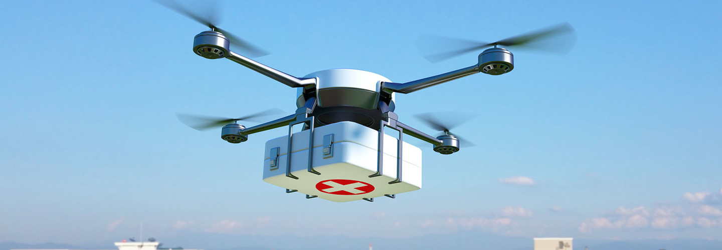 Drone with first aid kit flying over the town.