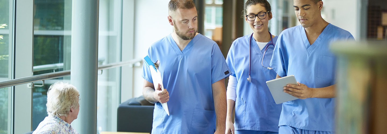 Team of doctors looking at EMR/EHR on tablet