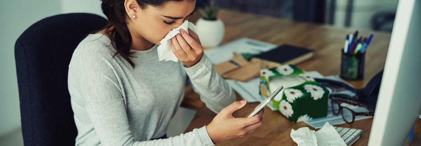 Girl sick with flu on her smartphone