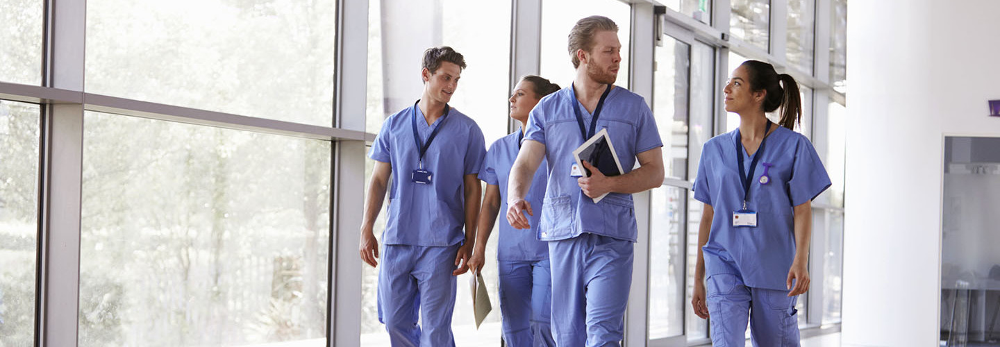 doctors walking through hospital chatting
