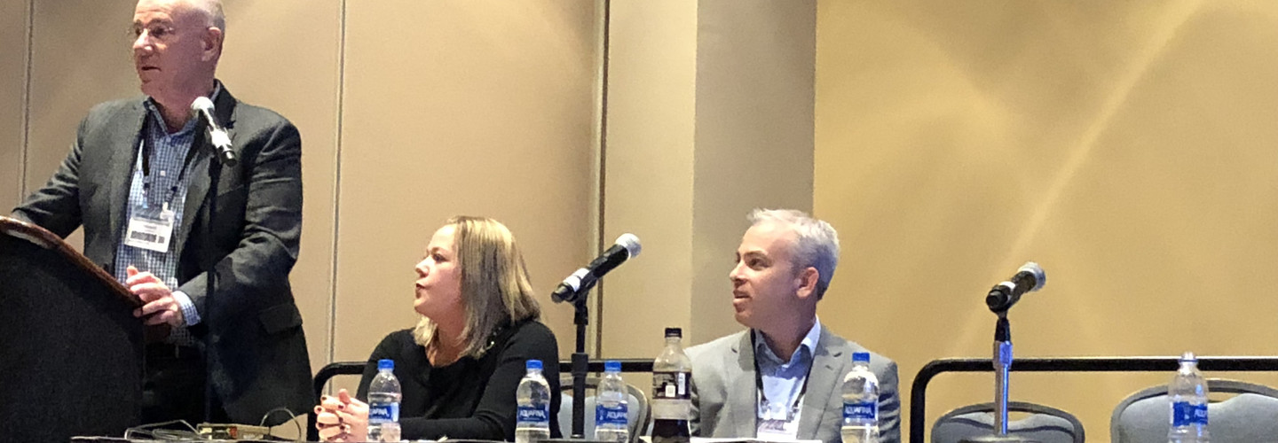 Microsoft Health's Dr. Clifford Goldsmith (left) talks at LeadingAge 2018 about the potential of artificial intelligence in senior care with MatrixCare's Megan Lenthe and Joe Weber.