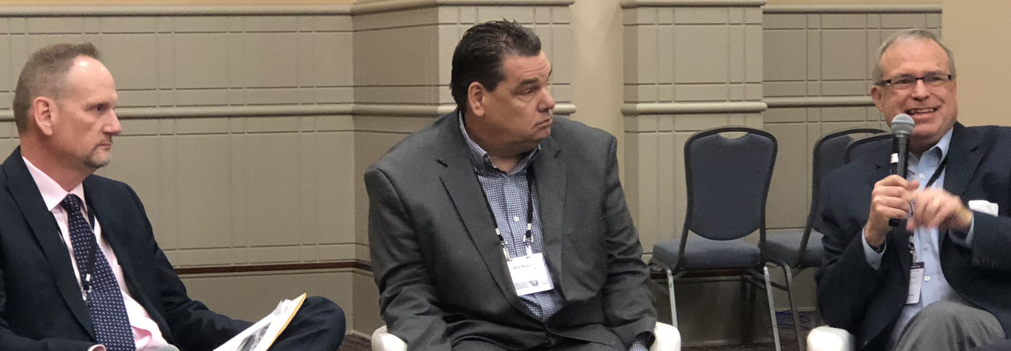 From left: Lifespace Communities VP of IT John Couture and Covenant Living Communities and Services CIO Bill Rabe listen as Acts Retirement-Life Communities Senior VP and CIO Peter Kress talks about the next generation of senior care CIOs.