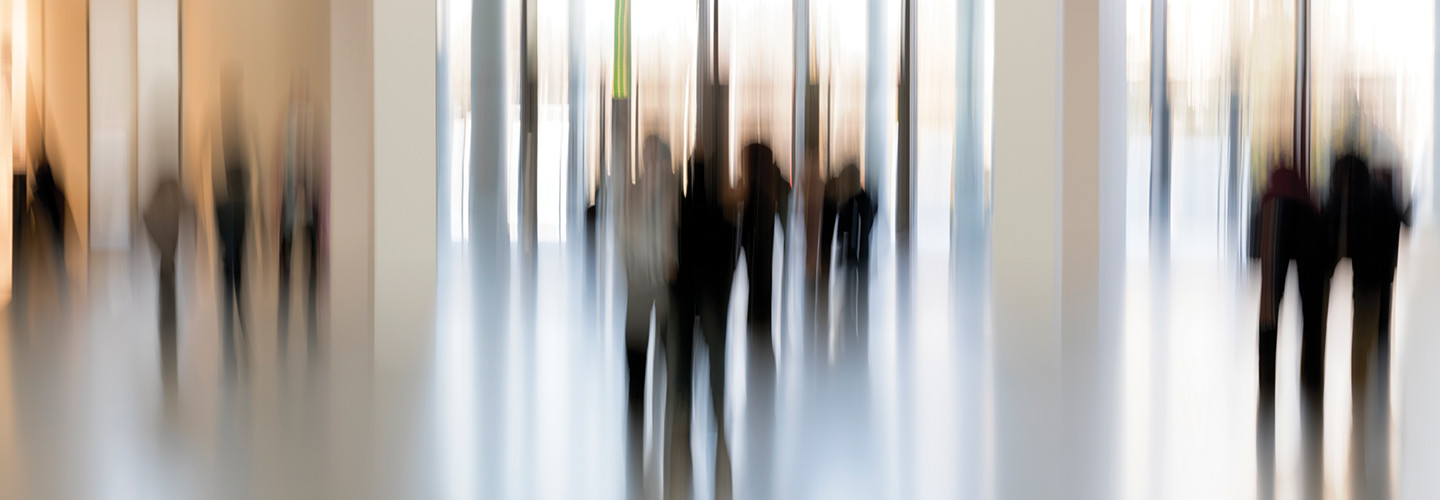 Blurred photo of people in a hospital