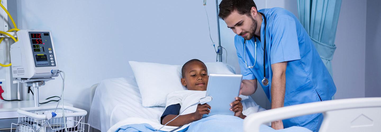 National Public Health Week — Male nurse and patient using digital tablet in ward