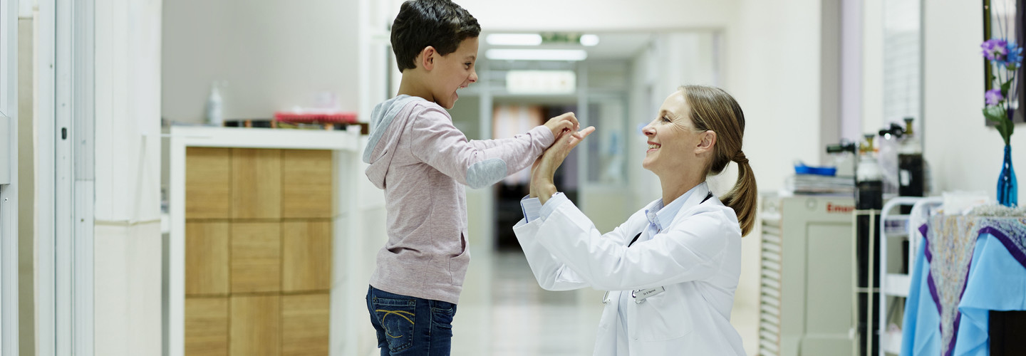 Child high fives doctor
