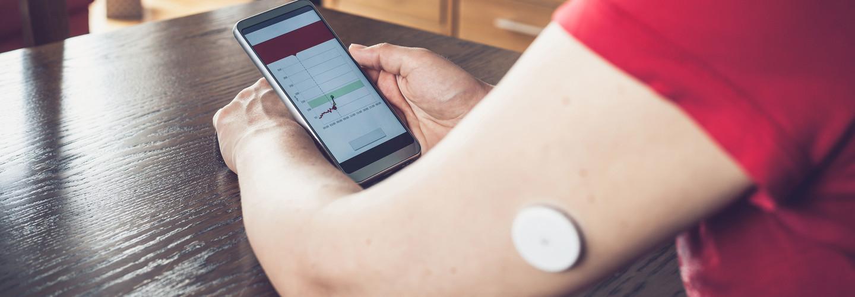 Woman monitors glucose levels