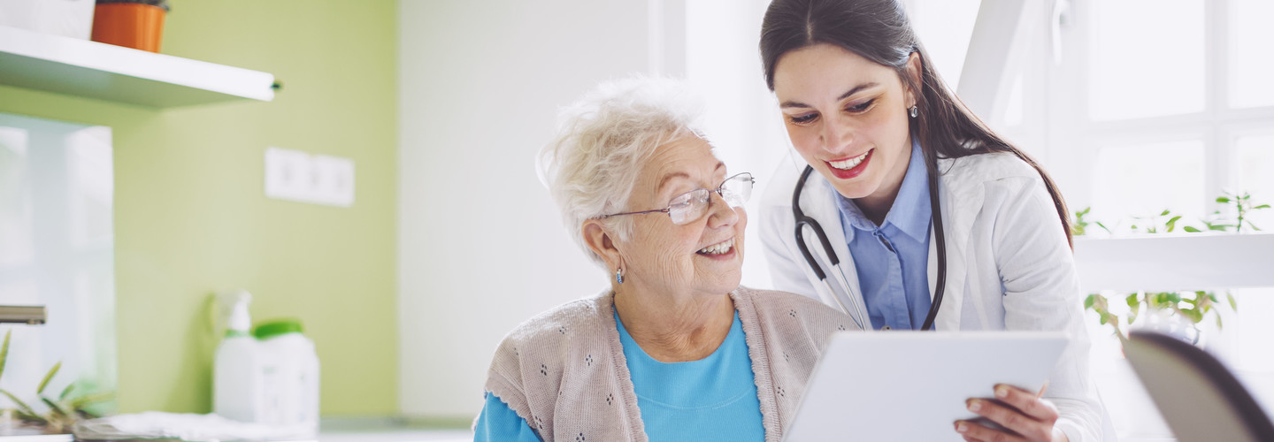 Doctor shows patient health record