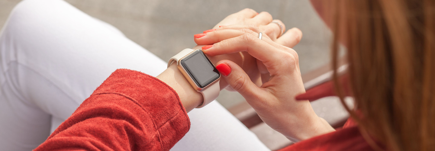 Woman looks at her smartwatch