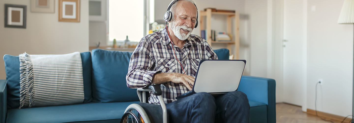older adult with tablet computer