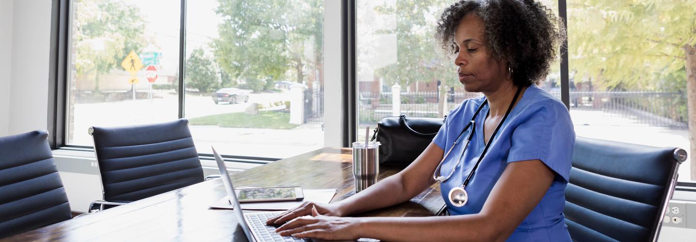 Nurse using laptop for telehealth