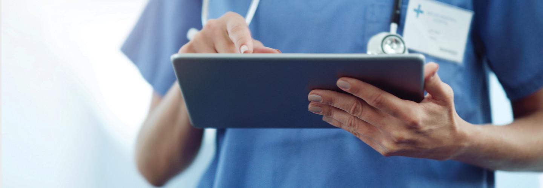 nurse using tablet in hospital