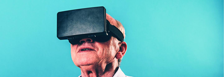 Senior man using VR headset