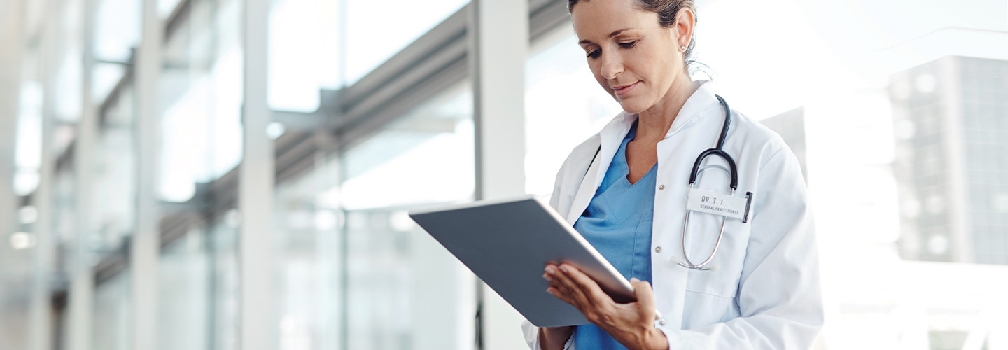Female doctor using a digital tablet.