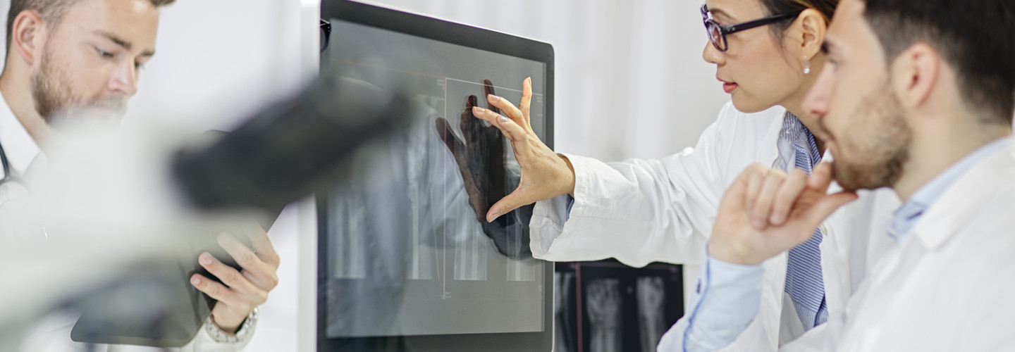 doctors looking at images on a screen