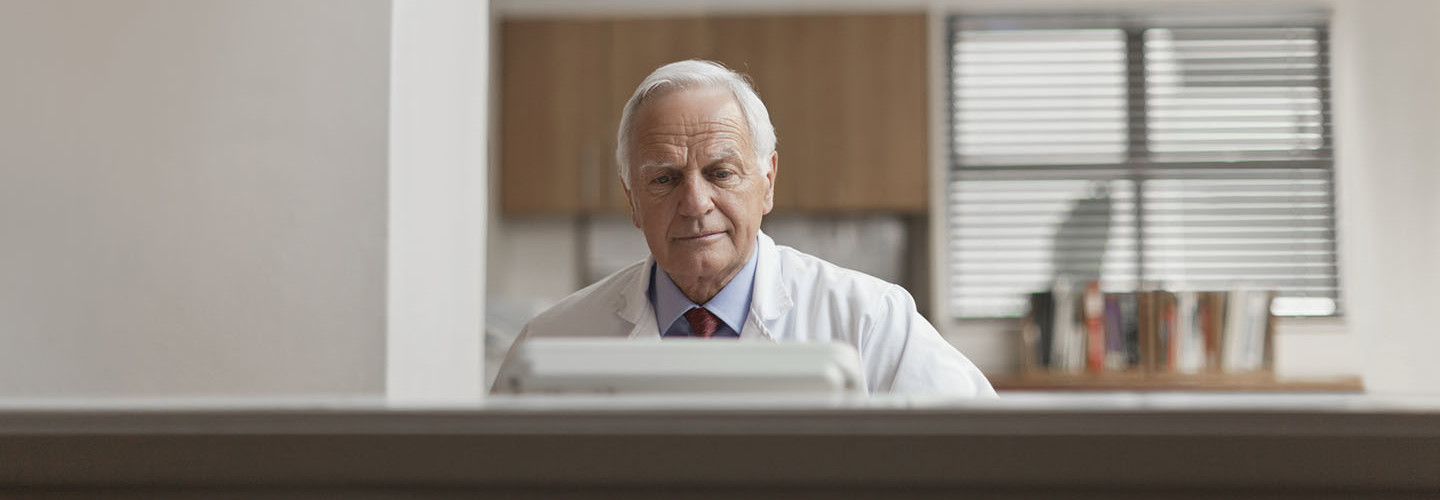 man at computer in doctor's office