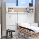 Empty hospital beds with tech