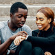 Man and woman look at smartwatch