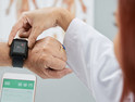 Doctor syncs wearable for patient