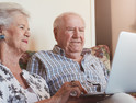 elderly couple using technology