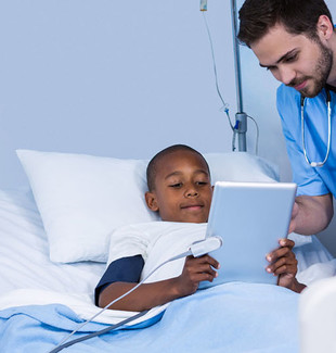 Male nurse and patient using digital tablet in ward