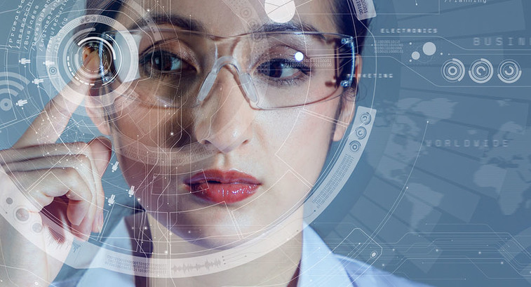 Young female doctor using augmented reality glasses.