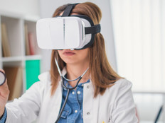 doctor wearing a virtual headset and using a stethoscope.