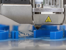A 3D printer printing prototypes in a biomedical classroom laboratory, close up view.