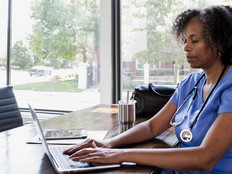 Nurse using laptop for telehealth