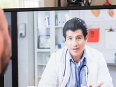 Man speaking with doctor remotely on video call.