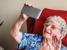 Elderly woman using a mobile telephone.