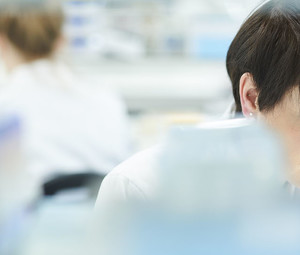 scientist in a busy research lab